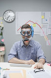 Office worker wearing scuba mask. Smiling office worker wearing scuba mask with negative business chart on background Royalty Free Stock Photo