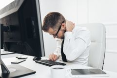 Free Office Worker With Pain From Sitting At Desk All Day Royalty Free Stock Photo - 150703795