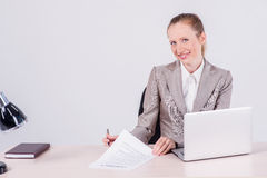 Office worker. Woman Businessman sitting at the table and typing stock photo