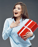 Office worker woman hold red gift. Royalty Free Stock Images