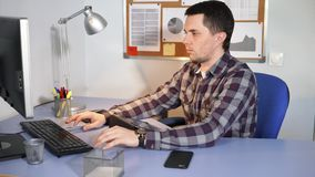 Office worker at work. Man sitting at the desk and using tablet. stock video