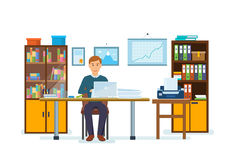 An office worker is working at computer, working with documents. Office workplace with table. Business man is working at a computer, working with documents, on Stock Image