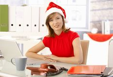 Office worker with xmas hat Stock Photography