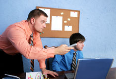 Office workers. With remote at desk Royalty Free Stock Photos