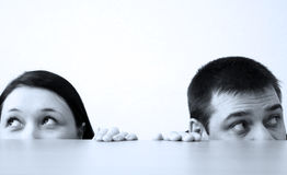 Office workers. Half faces under the table Stock Photo