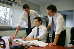 Office workers. Three men working together at the office Royalty Free Stock Photo