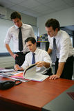 Office workers. Young businessmen working together at the office Stock Image