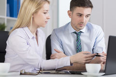 Office workers analyzing problem Stock Images