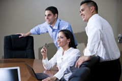 Office workers in boardroom watching presentation Royalty Free Stock Images