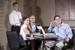 Office workers in boardroom watching presentation Royalty Free Stock Photo