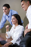 Office workers in boardroom watching presentation Royalty Free Stock Photos