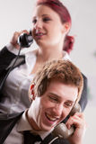 Office workers in a call center with phones Stock Image
