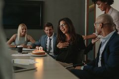 Business team celebrating colleague`s birthday in office Stock Photography