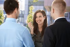 Office workers chatting at break time. Standing outside of office building stock images