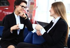 Office workers on coffee break, woman enjoying chatting. Office workers on coffee break, women enjoying chatting to colleagues, smiling Stock Photos