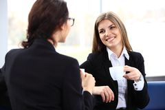 Office workers on coffee break, woman enjoying chatting Royalty Free Stock Image