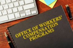 Office of Workers` Compensation Programs OWCP. Book with title Office of Workers` Compensation Programs OWCP Stock Photography