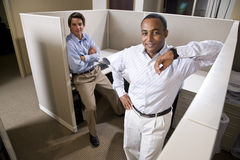 Office workers in cubicle Royalty Free Stock Images