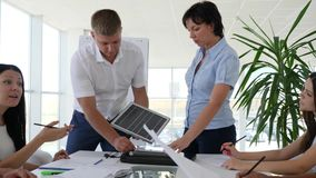 Office with workers discuss development operation solar panels and studying new technology. For table stock footage