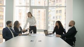 Office workers, employees of a large company, two young men and three young women discuss the firm`s issues, one of the. Women presents her project presenting stock video footage