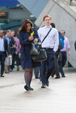 Office workers going at work. Early morning hours in Canary Wharf business life Royalty Free Stock Photography
