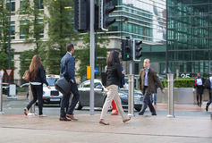 Office workers going at work. Early morning hours in Canary Wharf business life Stock Image