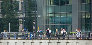 Office workers going at work. Early morning hours in Canary Wharf , London Royalty Free Stock Photo