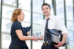 Office workers greet  outdoor Royalty Free Stock Image
