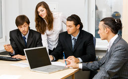 Office workers having a discussion Stock Image