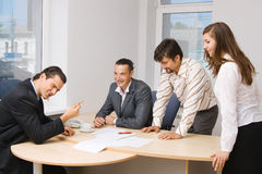 Office workers having a discussion Stock Photography