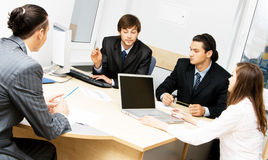 Office workers having a discussion Stock Photo