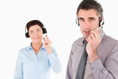 Office workers with headsets Royalty Free Stock Photos