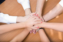 Office workers hold hands together Royalty Free Stock Photos