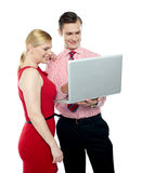 Office workers holding a laptop Royalty Free Stock Photo