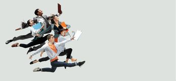 Office workers jumping  on studio background stock image