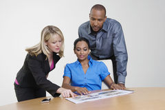 Office Workers With Manager In A Meeting Royalty Free Stock Photos
