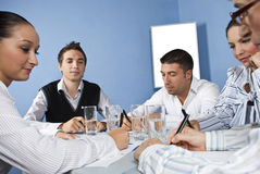 Office workers in the middle of business meeting Stock Photo