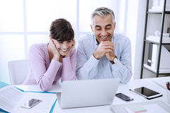 Office workers networking with a laptop Stock Photo