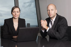 Office workers at office table Stock Images