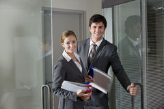 Office Workers Opening Boardroom Door Royalty Free Stock Photos