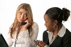 Office workers and phones Royalty Free Stock Photography