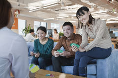 Office Workers Relaxing and Playing Cards in the Office Stock Image