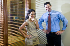 Office workers standing in boardroom Royalty Free Stock Photography