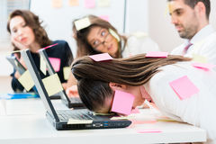 Office workers are stressed and overworked Stock Photo