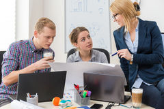 Office workers talking Royalty Free Stock Images