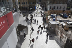 Office workers walking on the street towards London Bridge. View from above. From each person`s long shadows Stock Image