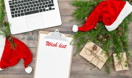 Office working place Christmas decoration wrapped gifts Wish lis. Office working place with Christmas decoration and wrapped gifts. Wish list Stock Image