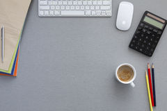 Office working place on grey wooden table Royalty Free Stock Photos