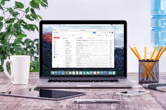 Office workplace with Apple Macbook with Google Gmail web page stock photography