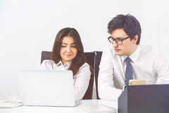Office workplace businesspeople. Office workplace with two businesspeople looking at laptop screen royalty free stock photos